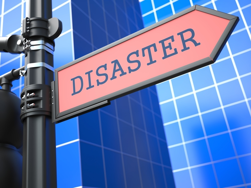 """Disaster Concept. """"Disaster"""" Red Roadsign Arrow on Blue Background..jpeg"""